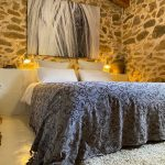 bedroom in natural stone spanish cottage